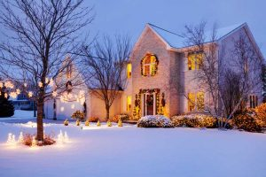 front of house in snow - realtor